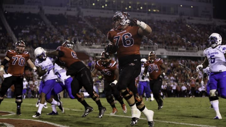BOCA RATON, FL – DECEMBER 20: Forrest Lamp #76 of the Western Kentucky Hilltoppers scores a touchdown during the first half of the game against the Memphis Tigers at FAU Stadium on December 20, 2016 in Boca Raton, Florida. (Photo by Rob Foldy/Getty Images)