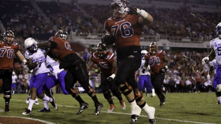 BOCA RATON, FL - DECEMBER 20: Forrest Lamp #76 of the Western Kentucky Hilltoppers scores a touchdown during the first half of the game against the Memphis Tigers at FAU Stadium on December 20, 2016 in Boca Raton, Florida. (Photo by Rob Foldy/Getty Images)