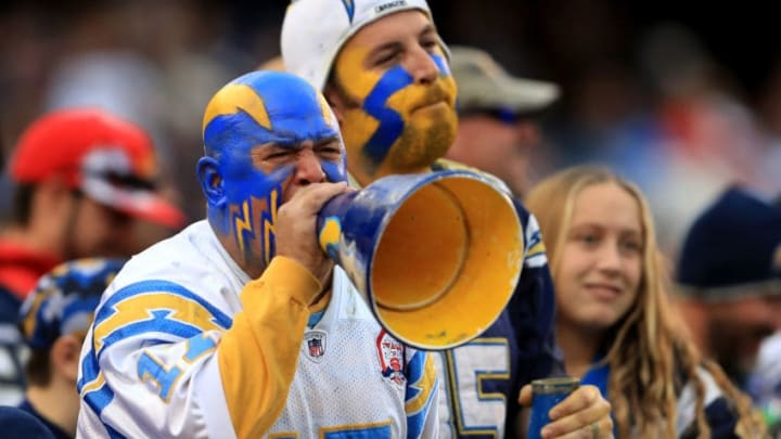 SAN DIEGO, CA - JANUARY 01: A San Diego Chargers fan yells through a megaphone in a game against the Kansas City Chiefs during the second half of a game at Qualcomm Stadium on January 1, 2017 in San Diego, California. (Photo by Sean M. Haffey/Getty Images)