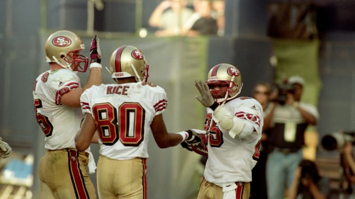 3 Dec 2000: Charlie Garner #25 and Jerry Rice #80 of the San Francisco 49ers celebrate after the game against the San Diego Chargers at Qualcomm Stadium in San Diego, California. The 49ers defeated the Chargers 45-17.Mandatory Credit: Christopher Ruppel /Allsport
