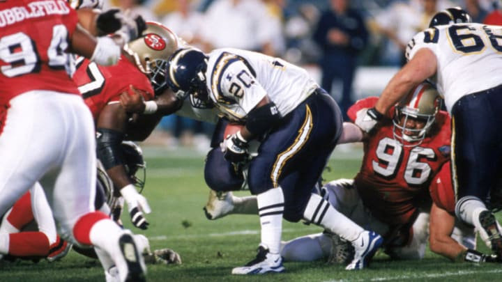 MIAMI - JANUARY 29: Running back Natrone Means #20 of the San Diego Chargers lowers his shoulders as he battles for extra yards against the San Francisco 49ers in Super Bowl XXIX at Joe Robbie Stadium on January 29, 1995 in Miami, Florida. The 49ers won 49-26. (Photo by George Rose/Getty Images)