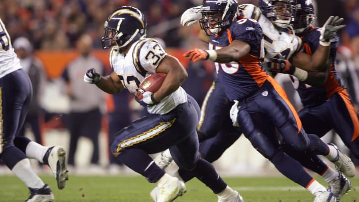 DENVER – NOVEMBER 19: Michael Turner #33 of the San Diego Chargers carries the ball against Louis Green#53 of the Denver Broncos on November 19, 2006 at Invesco Field at Mile High in Denver, Colorado. The Chargers defeated the Broncos 35-27 (Photo by Doug Pensinger/Getty Images)