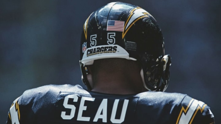 Junior Seau #8, Linebacker for the San Diego Chargers has a stars and stripes sticker placed on his helmet following the terrorist attacks on New York during the National Football Conference East game against the Dallas Cowboys on 23 September 2001 at theTexas Stadium, Irving, Texas, United States. The Chargers won the game 32 - 21. (Photo by Ronald Martinez/Getty Images)