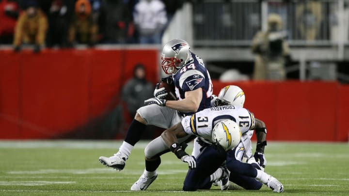 FOXBORO, MA – JANUARY 20: Heath Evans #44 of the New England Patriots runs with the ball against Antonio Cromartie #31 of the San Diego Chargers during the AFC Championship Game on January 20, 2008 at Gillette Stadium in Foxboro, Massachusetts. Patriots won 21-12. (Photo by Al Bello/Getty Images)