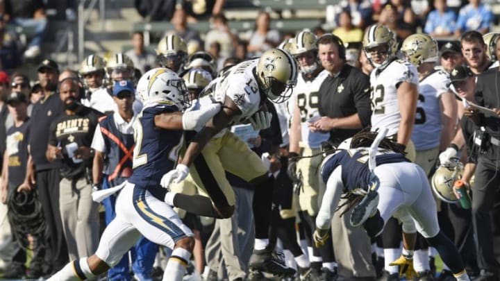 CARSON, CA - AUGUST 20: Wide receiver Michael Thomas #13 of the New Orleans Saints rushes after catching a pass against cornerback Trevor Williams #42 and Tre Boston #33 of the Los Angeles Chargers during the first half of their preseason football game at the StubHub Center August 20, 2017, in Carson, California. (Photo by Kevork Djansezian/Getty Images)