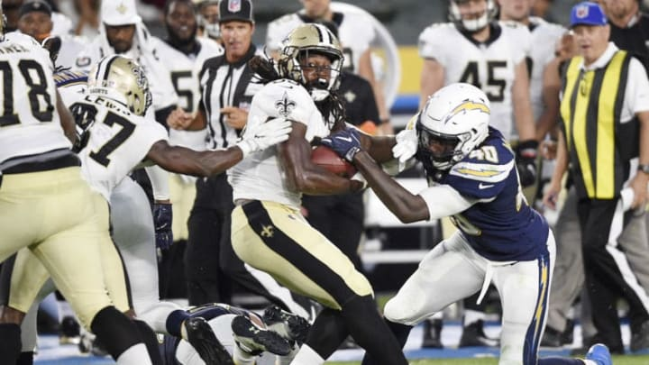 CARSON, CA - AUGUST 20: Running back Darius Victor #34 of the New Orleans Saints hangs on to the ball as defensive end Chris McCain #40 of the Los Angeles Chargers tries to strip it from him during the second half of a preseason football game against the New Orleans Saints at the StubHub Center August 20, 2017, in Carson, California. (Photo by Kevork Djansezian/Getty Images)