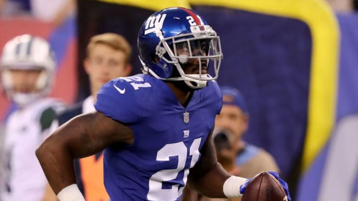 EAST RUTHERFORD, NJ - AUGUST 26: Landon Collins #21 of the New York Giants heads for the endzone and scores a touchdown in the first quarter against the New York Jets during a preseason game on August 26, 2017 at MetLife Stadium in East Rutherford, New Jersey (Photo by Elsa/Getty Images)