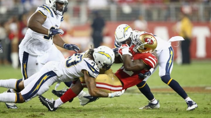 SANTA CLARA, CA - AUGUST 31: Joe Williams #32 of the San Francisco 49ers is tacked by Dexter McCoil #23 and Brandon Stewart #39 of the Los Angeles Chargers at Levi's Stadium on August 31, 2017 in Santa Clara, California. (Photo by Ezra Shaw/Getty Images)
