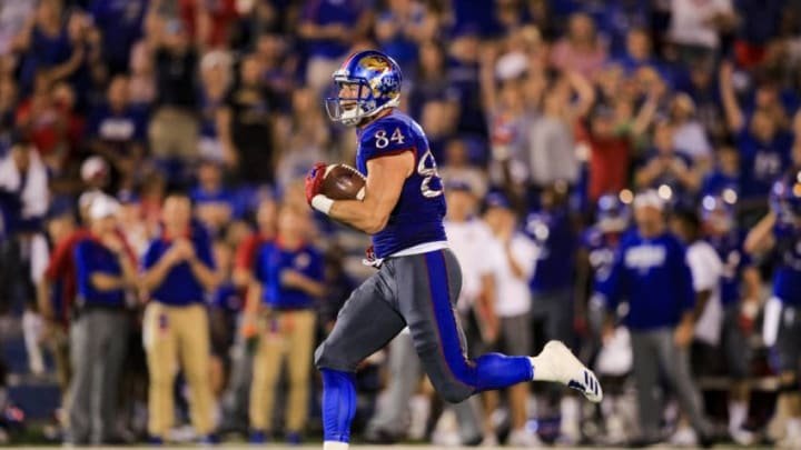 LAWRENCE, KS - SEPTEMBER 02: Ben Johnson #84 of the Kansas Jayhawks completes a pass for a touchdown during the game against the Southeast Missouri State Redhawks on September 2, 2017 in Lawrence, Kansas. (Photo by Brian Davidson/Getty Images)