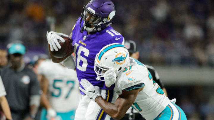 MINNEAPOLIS, MN - AUGUST 31: A.J. Hendy #37 of the Miami Dolphins pushes Cayleb Jones #16 of the Minnesota Vikings out of bounds in the preseason game on August 31, 2017 at U.S. Bank Stadium in Minneapolis, Minnesota. The Dolphins defeated the Vikings 30-9. (Photo by Hannah Foslien/Getty Images)