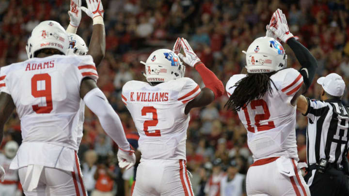 TUCSON, AZ - SEPTEMBER 09: Safety Khalil Williams #2 and linebacker D'Juan Hines #12 of the Houston Cougars signal a safety during the second half of the game against the Arizona Wildcats at Arizona Stadium on September 9, 2017 in Tucson, Arizona. The Houston Cougars won 19-16. (Photo by Jennifer Stewart/Getty Images)