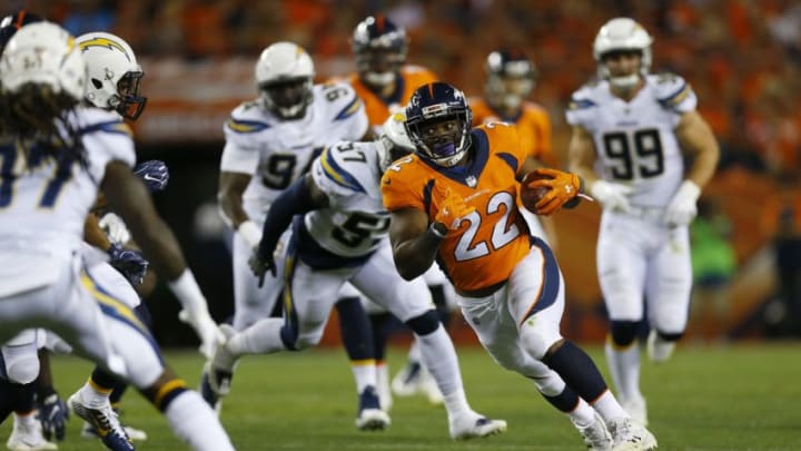 DENVER, CO - SEPTEMBER 11: Running back C.J. Anderson #22 of the Denver Broncos rushes with the ball in the first quarter of the game against the Los Angeles Chargers at Sports Authority Field at Mile High on September 11, 2017 in Denver, Colorado. (Photo by Justin Edmonds/Getty Images)