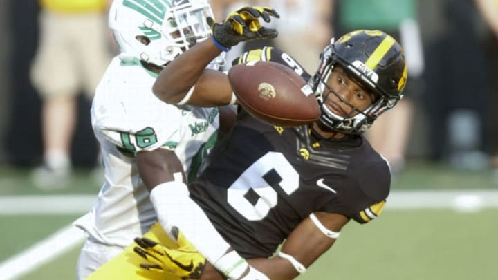 IOWA CITY, IOWA- SEPTEMBER 16: Defensive back Kemon Hall #16 of the North Texas Mean Green breaks up a pass in the fourth quarterintended for wide receiver Ihmir Smith-Marsette of the Iowa Hawkeyes, on September 16, 2017 at Kinnick Stadium in Iowa City, Iowa. (Photo by Matthew Holst/Getty Images)