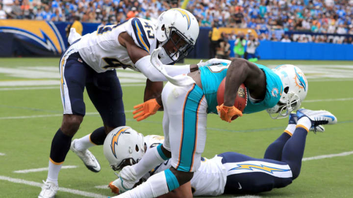 CARSON, CA - SEPTEMBER 17: Jakeem Grant #19 of the Miami Dolphins returns the punt and tries to get around Michael Davis #43 of the Los Angeles Chargers and Charmeachealle Moore #50 of the Los Angeles Chargers during the NFL game at the StubHub Center on September 17, 2017 in Carson, California. (Photo by Sean M. Haffey/Getty Images)