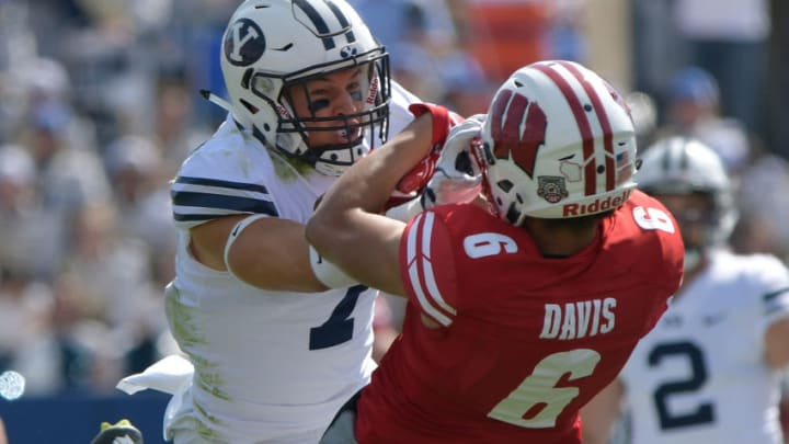 PROVO, UT - SEPTEMBER 16: Micah Hannemann #7 of the BYU Cougars defends against Danny Davis III #6 of the Wisconsin Badgers during a game at LaVell Edwards Stadium on September 16, 2017 in Provo, Utah. (Photo by Gene Sweeney Jr/Getty Images)