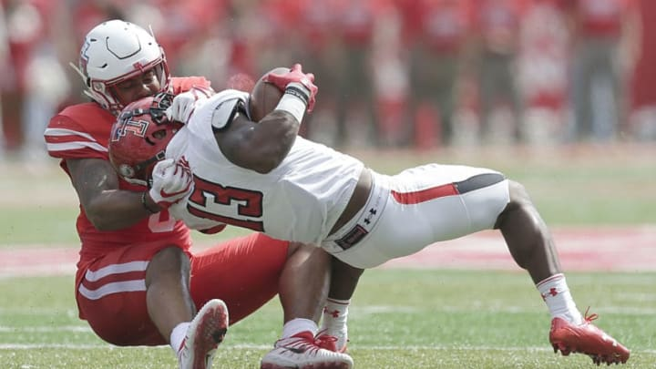 HOUSTON, TX - SEPTEMBER 23: Emeke Egbule #8 of the Houston Cougars tackles Noah Hess #43 of the Texas Tech Red Raiders in the first quarter at TDECU Stadium on September 23, 2017 in Houston, Texas. (Photo by Thomas B. Shea/Getty Images)