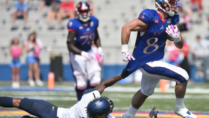 LAWRENCE, KS – SEPTEMBER 23: Ben Johnson #84 of the Kansas Jayhawks has his shirt pulled by Derrek Pitts Jr. #1 of the West Virginia Mountaineers as he looks for running room in the fourth quarter at Memorial Stadium on September 23, 2017 in Lawrence, Kansas. (Photo by Ed Zurga/Getty Images)