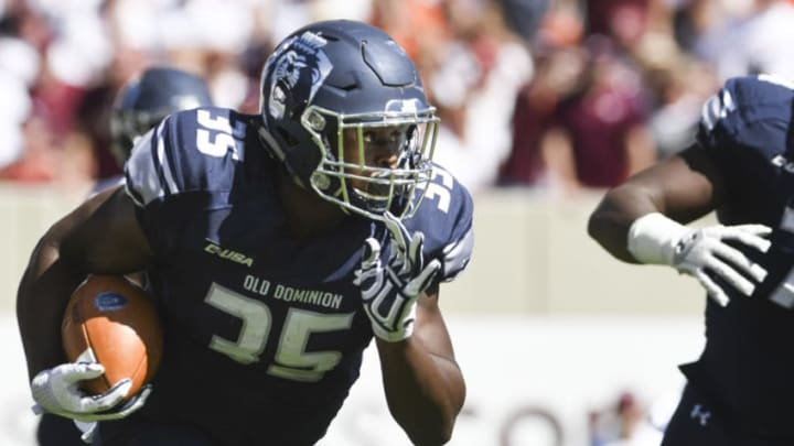 BLACKSBURG, VA - SEPTEMBER 23: Running back Jeremy Cox #35 of the Old Dominion University Monarchs carries the ball against the Virginia Tech Hokies in the first half at Lane Stadium on September 23, 2017 in Blacksburg, Virginia. Virginia Tech defeated Old Dominion 38-0 (Photo by Michael Shroyer/Getty Images)