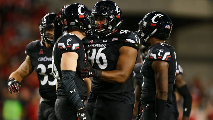 CINCINNATI, OH – SEPTEMBER 30: Cortez Broughton #96 celebrates with Carter Jacobs #20 of the Cincinnati Bearcats after a tackle against the Marshall Thundering Herd during the first half at Nippert Stadium on September 30, 2017 in Cincinnati, Ohio. (Photo by Michael Reaves/Getty Images)
