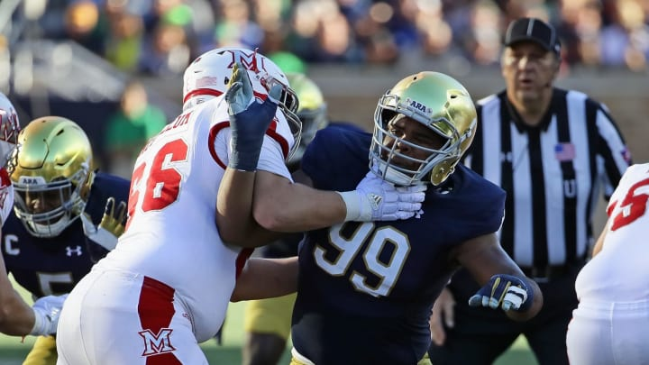 SOUTH BEND, IN – SEPTEMBER 30: Jerry Tillery #99 of the Notre Dame Fighting Irish rushes against Sam McCollum #66 of the Miami (Oh) Redhawks at Notre Dame Stadium on Seotember 30, 2017 in South Bend, Indiana. Notre Dame defeated Miami (OH) 52-17. (Photo by Jonathan Daniel/Getty Images)