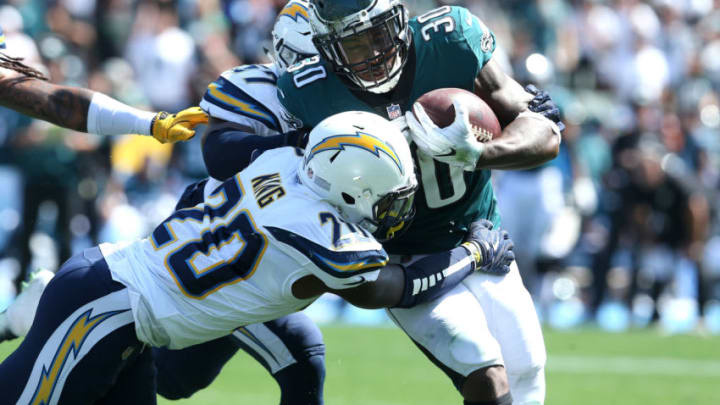 CARSON, CA - OCTOBER 01: Desmond King #20 of the Los Angeles Chargers attempts to tackle Corey Clement #30 of the Philadelphia Eagles during the first half at StubHub Center on October 1, 2017 in Carson, California. (Photo by Stephen Dunn/Getty Images)