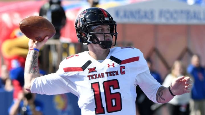 LAWRENCE, KS - OCTOBER 7: Quarterback Nic Shimonek #16 of the Texas Tech Red Raiders looks to pass against Kansas Jayhawks in the second quarter at Memorial Stadium on October 7, 2017 in Lawrence, Kansas. (Photo by Ed Zurga/Getty Images)