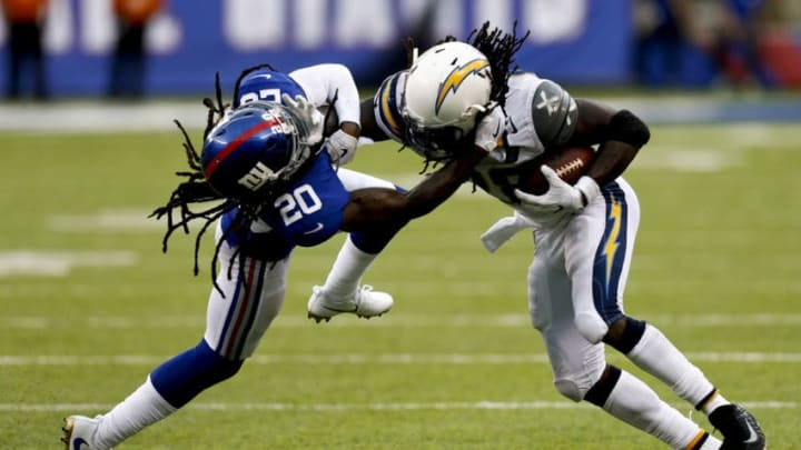 EAST RUTHERFORD, NJ - OCTOBER 08: Melvin Gordon #28 of the Los Angeles Chargers breaks free of Janoris Jenkins #20 of the New York Giants during their game at MetLife Stadium on October 8, 2017 in East Rutherford, New Jersey. (Photo by Jeff Zelevansky/Getty Images)