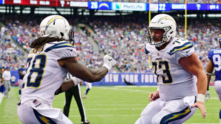 EAST RUTHERFORD, NJ - OCTOBER 08: Melvin Gordon #28 of the Los Angeles Chargers is congratulated by his teammate Spencer Pulley #73 after scoring a fourth quarter touchdown against the New York Giants during an NFL game at MetLife Stadium on October 8, 2017 in East Rutherford, New Jersey. (Photo by Steven Ryan/Getty Images)
