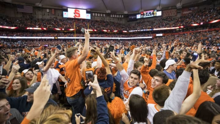 SYRACUSE, NY - OCTOBER 13: Syracuse Orange fans storm the field after the team upset Clemson Tigers at the Carrier Dome on October 13, 2017 in Syracuse, New York. Syracuse defeats Clemson 27-24. (Photo by Brett Carlsen/Getty Images)