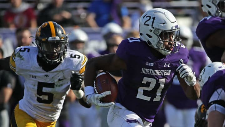 EVANSTON, IL - OCTOBER 21: Justin Jackson #21 of the Northwestern Wildcats is chased by Manny Rugamba #5 of the Iowa Hawkeyes at Ryan Field on October 21, 2017 in Evanston, Illinois. Northwestern defeated Iowa 17-10 in overtime. (Photo by Jonathan Daniel/Getty Images)
