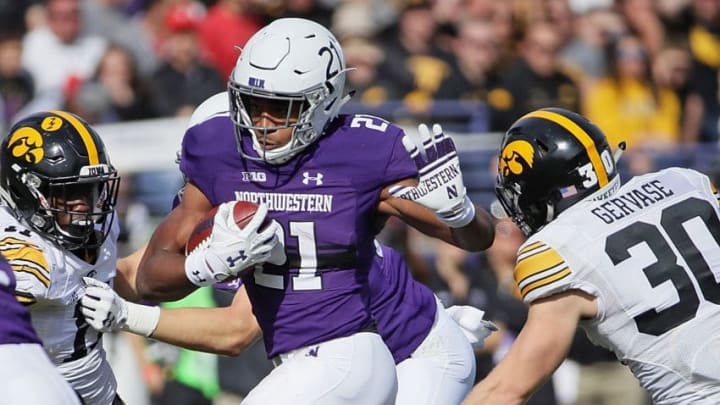 EVANSTON, IL - OCTOBER 21: Justin Jackson #21 of the Northwestern Wildcats as Jake Gervase #30 of the Iowa Hawkeyes closes in at Ryan Field on October 21, 2017 in Evanston, Illinois. (Photo by Jonathan Daniel/Getty Images)