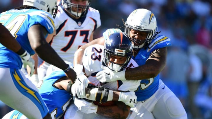CARSON, CA - OCTOBER 22: Darius Philon #93 of the Los Angeles Chargers tackles Devontae Booker #23 of the Denver Broncos during the second quarter of the game at the StubHub Center on October 22, 2017 in Carson, California. (Photo by Harry How/Getty Images)
