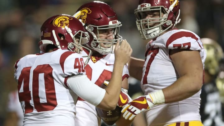 BOULDER, CO - NOVEMBER 11: Erik Krommenhoek #84 of the USC Trojans is congratulated by Chase McGrath #40 and Chris Brown #77 after scoring on a two point conversion against the Colorado Buffaloes at Folsom Field on November 11, 2017 in Boulder, Colorado. (Photo by Matthew Stockman/Getty Images)