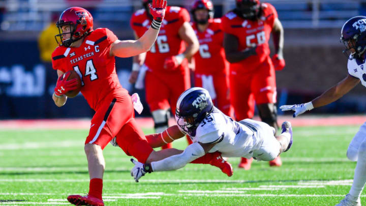 LUBBOCK, TX - NOVEMBER 18: Dylan Cantrell #14 of the Texas Tech Red Raiders tries to break the tackle of Sammy Douglas #35 of the TCU Horned Frogs during the game on November 18, 2017 at Jones AT&T Stadium in Lubbock, Texas. TCU defeated Texas Tech 27-3. (Photo by John Weast/Getty Images)
