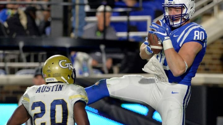 DURHAM, NC - NOVEMBER 18: Daniel Helm #80 of the Duke Blue Devils makes a touchdown catch against Lawrence Austin #20 of the Georgia Tech Yellow Jackets during their game at Wallace Wade Stadium on November 18, 2017 in Durham, North Carolina. Duke won 43-20. (Photo by Grant Halverson/Getty Images)