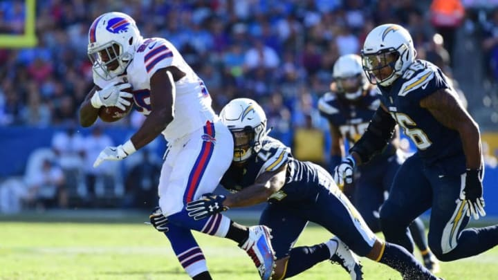 CARSON, CA - NOVEMBER 19: Trevor Williams #24 of the Los Angeles Chargers tackles LeSean McCoy #25 of the Buffalo Bills during the first half of the game at StubHub Center on November 19, 2017 in Carson, California. (Photo by Harry How/Getty Images)