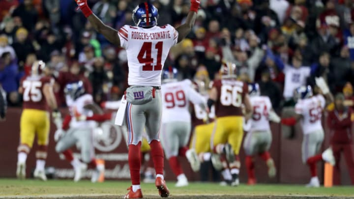LANDOVER, MD - NOVEMBER 23: Cornerback Dominique Rodgers-Cromartie #41 of the New York Giants celebrates as Janoris Jenkins #20 (not pictured) returns an interception for a third quarter touchdown against the Washington Redskins at FedExField on November 23, 2017 in Landover, Maryland. (Photo by Rob Carr/Getty Images)