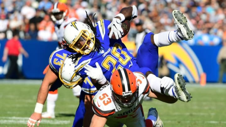 CARSON, CA - DECEMBER 03: Melvin Gordon #28 of the Los Angeles Chargers is hit by Joe Schobert #53 of the Cleveland Browns during the second quarter of the game at StubHub Center on December 3, 2017 in Carson, California. (Photo by Harry How/Getty Images)