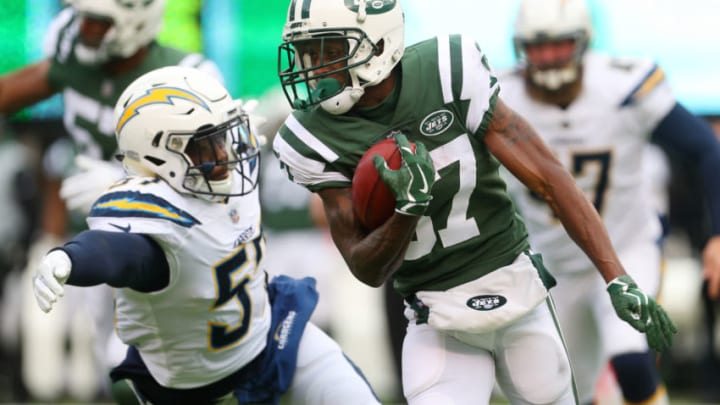 EAST RUTHERFORD, NJ - DECEMBER 24: Chris Gragg #87 of the New York Jets attempts to avoid the tackle of Jatavis Brown #57 of the Los Angeles Chargers during the first half of an NFL game at MetLife Stadium on December 24, 2017 in East Rutherford, New Jersey. (Photo by Ed Mulholland/Getty Images)