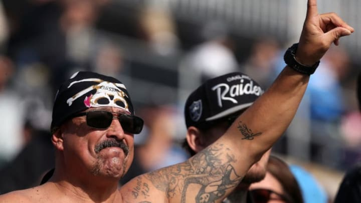 CARSON, CA - DECEMBER 31: An Oakland Raiders fan is seen prior to the game against the Los Angeles Chargers at StubHub Center on December 31, 2017 in Carson, California. (Photo by Stephen Dunn/Getty Images)