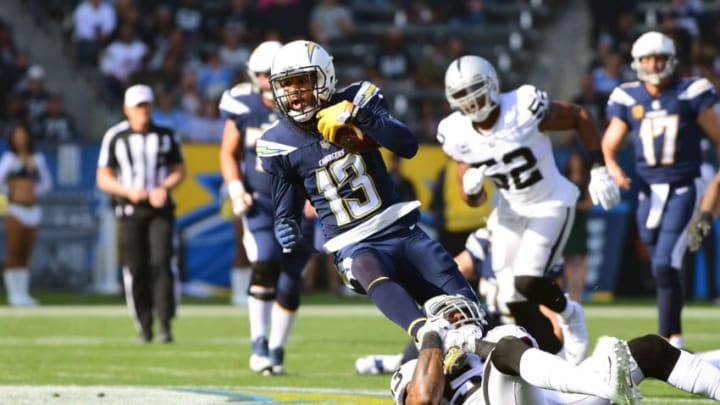 CARSON, CA - DECEMBER 31: Keenan Allen #13 of the Los Angeles Chargers makes the catch for a first down as he is being tackled by NaVorro Bowman #53 of the Oakland Raiders during the first quarter of the game at StubHub Center on December 31, 2017 in Carson, California. (Photo by Harry How/Getty Images)