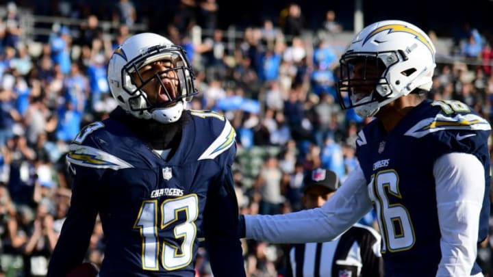 CARSON, CA - DECEMBER 31: Keenan Allen #13 of the Los Angeles Chargers reacts to his touchdown catch in front of Tyrell Williams #16 to take a 20-10 lead over the Oakland Raiders during the first half at StubHub Center on December 31, 2017 in Carson, California. (Photo by Harry How/Getty Images)
