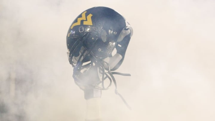 MORGANTOWN, WV - NOVEMBER 25: A member of the West Virginia Mountaineers holds up his helmet before the take the field against the University of Pittsburgh Panthers during the 2011 Backyard Brawl on November 25, 2011 at Mountaineer Field in Morgantown, West Virginia. (Photo by Jared Wickerham/Getty Images)