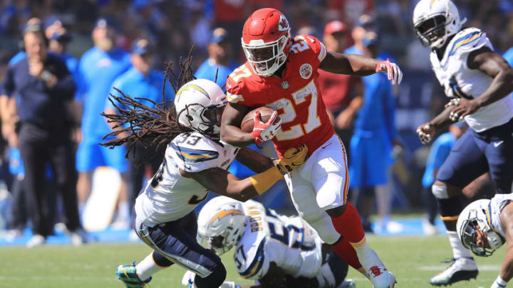 CARSON, CA - SEPTEMBER 24: Kareem Hunt #27 of the Kansas City Chiefs avoids the tackle against Tre Boston #33 of the Los Angeles Chargers during the NFL game at the StubHub Center on September 24, 2017 in Carson, California. (Photo by Sean M. Haffey/Getty Images)