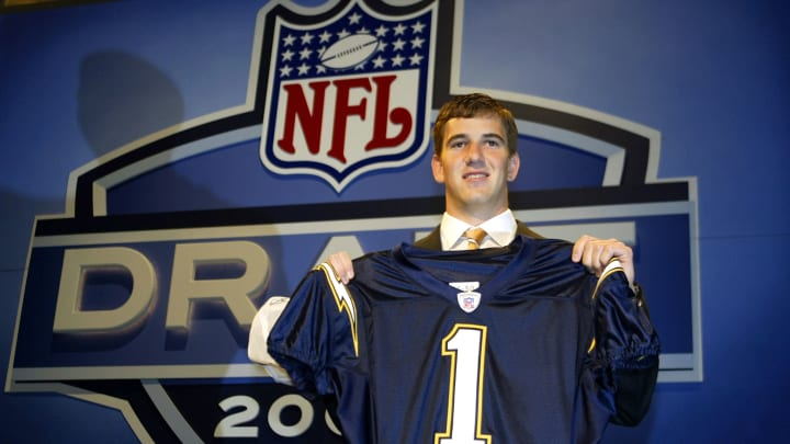 NEW YORK – APRIL 24: Eli Manning holding up a San Diego Chargers jersey was selected first pick overall by the Chargers then traded to the New York Giants for Philip Rivers and 3 draft picks during the 2004 NFL Draft on April 24, 2004, at Madison Square Garden in New York City. (Photo by Chris Trotman/Getty Images)