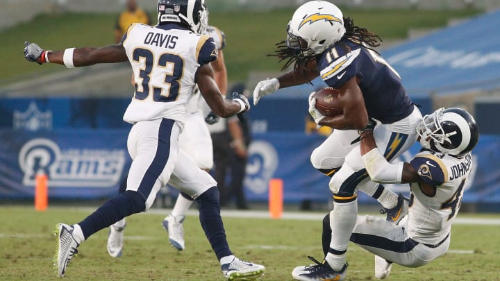 LOS ANGELES, CA – AUGUST 26: John Johnson III #43 of the Los Angeles Rams tackles Geremy Davis #11 of the Los Angeles Chargers during the preseason game between the Los Angeles Rams and Los Angeles Chargers at the Los Angeles Memorial Coliseum on August 26, 2017 in Los Angeles, California. (Photo by Josh Lefkowitz/Getty Images)