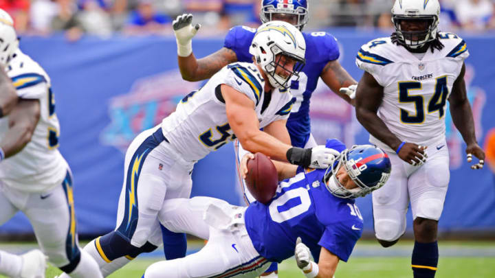 EAST RUTHERFORD, NJ - OCTOBER 08: Eli Manning #10 of the New York Giants is sacked by Joey Bosa #99 of the Los Angeles Chargers during the first quarter during an NFL game at MetLife Stadium on October 8, 2017 in East Rutherford, New Jersey. (Photo by Steven Ryan/Getty Images)