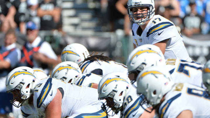 OAKLAND, CA - OCTOBER 15: Philip Rivers #17 of the Los Angeles Chargers goes under center against the Oakland Raiders during their NFL game at Oakland-Alameda County Coliseum on October 15, 2017 in Oakland, California. (Photo by Don Feria/Getty Images)