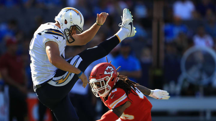 CARSON, CA – SEPTEMBER 24: Drew Kaser #8 of the Los Angeles Chargers punts the ball under pressure from Terrance Smith #48 of the Kansas City Chiefs during the second half of a game at StubHub Center on September 24, 2017 in Carson, California. (Photo by Sean M. Haffey/Getty Images)