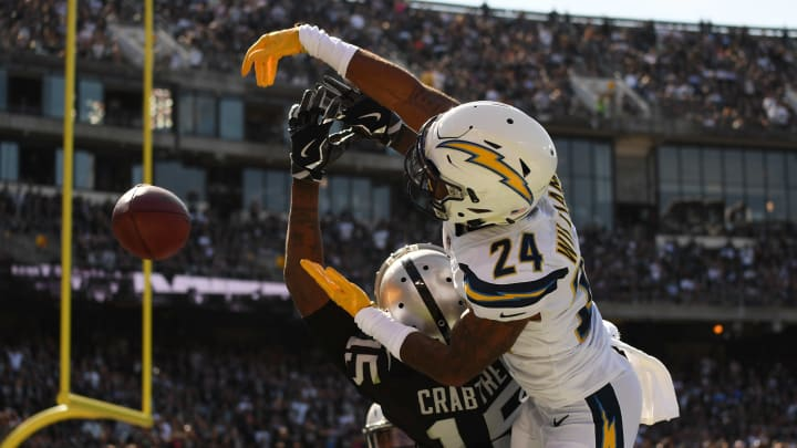 OAKLAND, CA – OCTOBER 15: Trevor Williams #24 of the Los Angeles Chargers defends a pass intended for Michael Crabtree #15 of the Oakland Raiders during their NFL game at Oakland-Alameda County Coliseum on October 15, 2017, in Oakland, California. (Photo by Thearon W. Henderson/Getty Images)